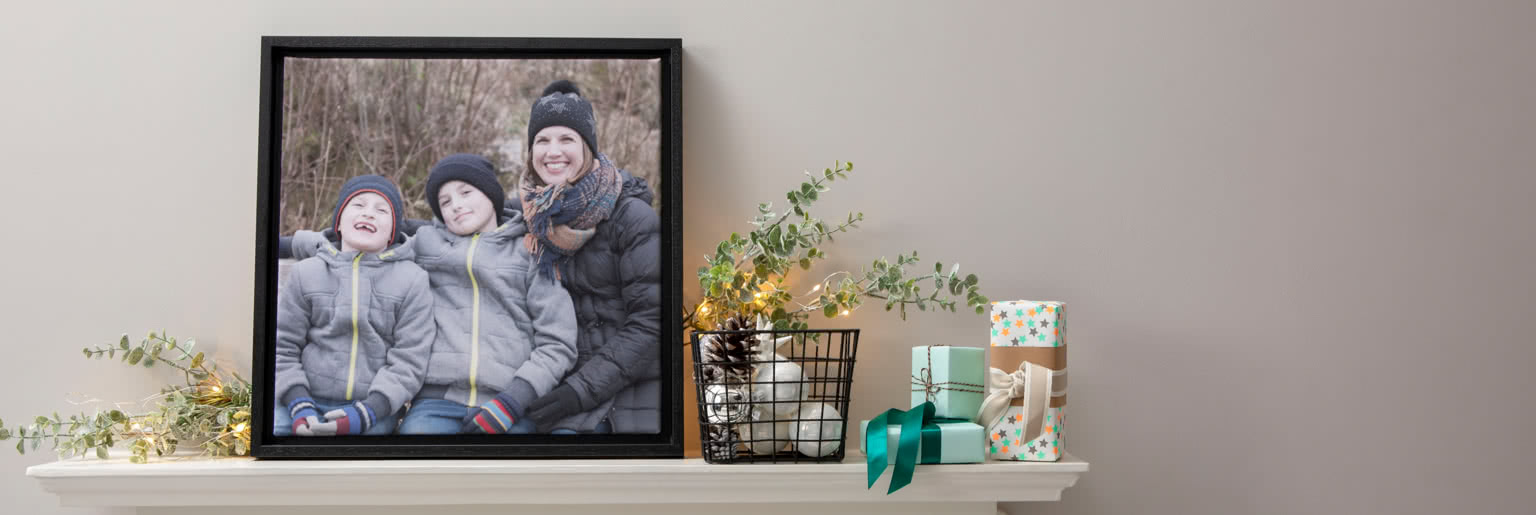 Framed canvases on a shelf