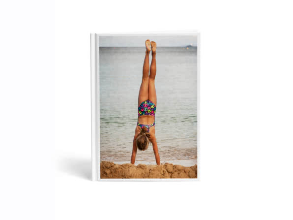 Portrait book with a cover depicting a girl doing a hand stand