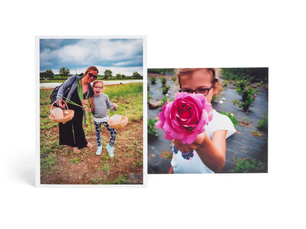 "7"" enlargement prints of two photos, one of mother and daughter, one where daughter is aiming a pink flower at the camera"