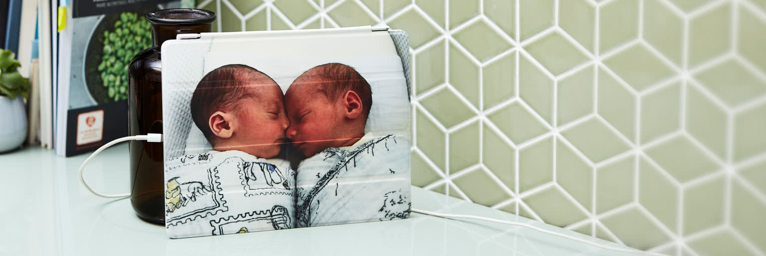 IPad with a personalised cover with a photo of two twin babies